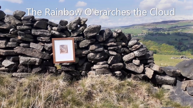 A still image introducing the video The Rainbow O'erarches the Cloud